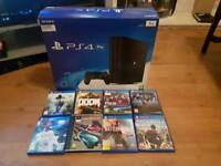 PLAYSTATION 4 PRO WITH 8 GAMES