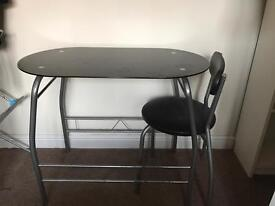 Glass breakfast table and chair