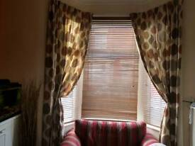 Curtains cushions and throw