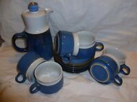 6 cups and saucers with coffee jug