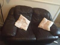 Faux leather two seater sofa for free!