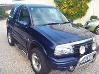 Soft top Suzuki Grand Vitara 1.6 GV Sport 3 Door 4 x 4. Metallic Blue. 2003.