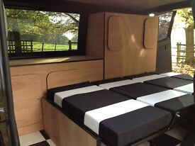 VW T4 Camper Interior and Rock and Roll Bed.