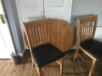 Solid oak extending table and 4 chairs - fits 6 adults comfortably when extended