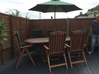HARDWOOD EXTENDING TABLE AND SIX CHAIRS