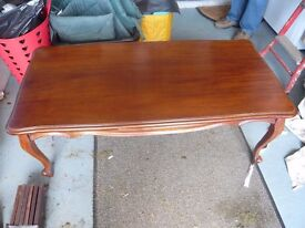 Solid mahogany coffee table.