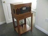 Record, CD, Cassette player and radio. Also free standing record table