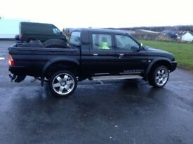 """multi fit 20"""" 4x4 wheels with new tyres in vgc. set of 4."""