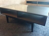 Coffee Table for sale. Ikea (Regissor) brand new, just assembled. Brown wood with glass top.