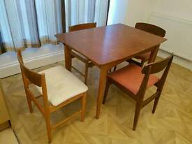 Extending table and 4 chairs solid wood