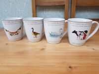 Twelve days of Christmas porcelain mugs. Still in original John Lewis box, never been used.