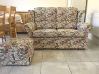 A beautiful two seater settee complete with pouffe.