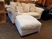DFS cream fabric two seater sofa with pull out sofa bed