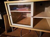 TV unit lots of storage and glass door