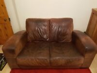 Brown two seater leather sofer and chair to match