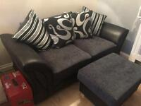 3 seater sofa and storage footstool in grey and black