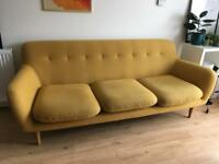 Beautiful and modern sofa in mustard yellow