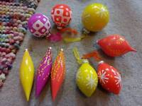 Designer Xmas baubles in bright colours yellow/orange/pink