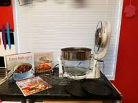 Halogen oven with books and utensils