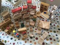 Large lot of wooden dolls house furniture