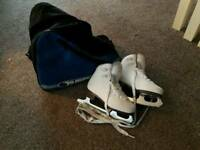 Kids size 11 ice skates with carry bag