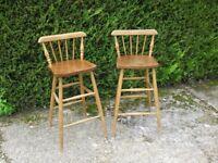 Two sturdy wooden breakfast-bar stools