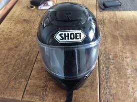 Showing motorbike helmet. Qwest.