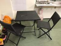 Two seater black rattan garden patio set in good condition folds up flat