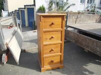 Tall solid wood chest drawers.
