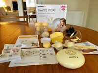 Medela Swing Maxi double breast pump with Lansinoh breast pads, cream , bags