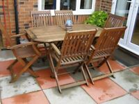Teak Table and 6 chairs in good condition .