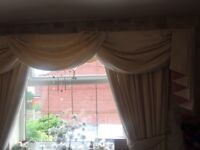 Cream curtains with swags and tails
