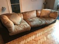 Really comfy large brown leather sofa and chaise longue.