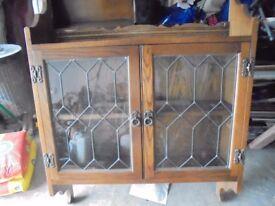 Old Charm oak cabinet.