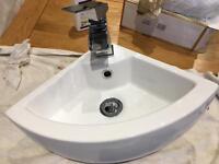 Corner sink cloak room waterfall tap