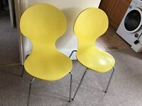Pair of yellow dining chairs