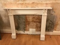Wooden fire surround painted white