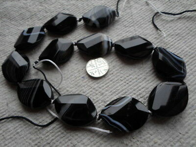 Strand of 30mm Black Sardonyx Faceted oval Beads