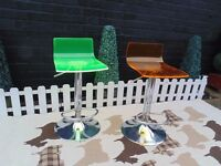 2 ACRYLIC ORANGE AND GREEN BAR STOOLS BOTH WORKING PERFECTLY IN VERY GOOD CONDITION