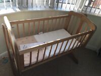 Mothercare natural wood rocking crib with breathe easy mattress. In excellent condition.