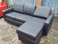 Lovely Brand New Black leather corner sofa. or use as 3 seater and puff. can deliver