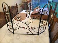 Pretty fire guard and candle holder