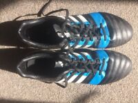 Blue black and white adidas boots worn once. 7 studs with 5 :2 formation and 2 smaller plastic studs