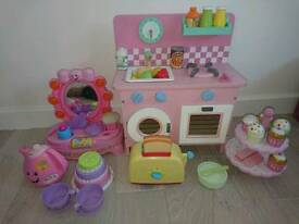 Small wooden kitchen and Fisher price laugh and learn musical mirror And tea pot and tea cake set