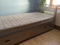 Single bed with mattress and metal storage drawer