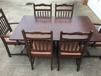 Refectory dining table and 6 chairs, two are carver chairs,in very good condition £100 o.n.o