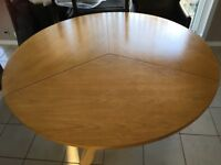 Large round wooden dining table and 6 chairs