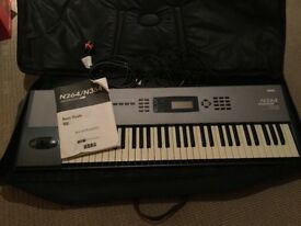 KORG N364 keyboard and amplifier and carry case