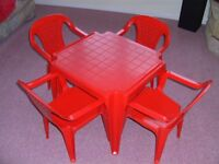 Plastic red table & chairs (4)