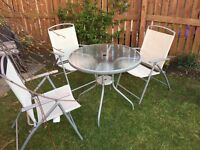 Set of 4 garden chairs and glass top table